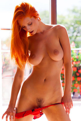 A redhead beauty Ariel flashing her boobs